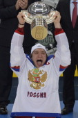 Russia's forward Alexander Ovechkin celebrates with the trophy a 52 victory during a gold medal game Russia vs Finland of the IIHF International Ice...
