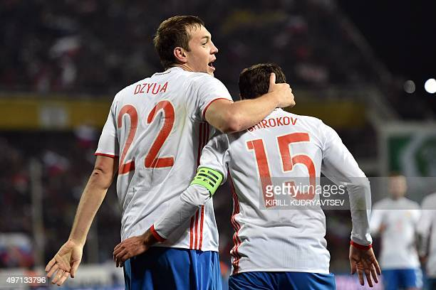 Russia's forward Artem Dzyuba and Russia's midfielder Roman Shirokov celebrate a goal during the friendly football match between Russia and Portugal...