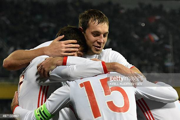 Russia's forward Artem Dzyuba and teammates celebrate a goal during the friendly football match between Russia and Portugal in Krasnodar on November...