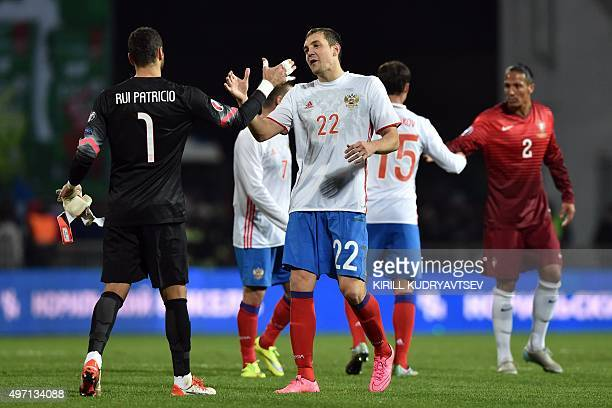 Russia's forward Artem Dzyuba shakes hands with Portugal's goalkeeper Rui Patricio after the friendly football match between Russia and Portugal in...