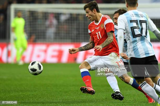 Russia's forward Fedor Smolov and Argentina's Giovani Lo Celso vie for the ball during an international friendly football match between Russia and...