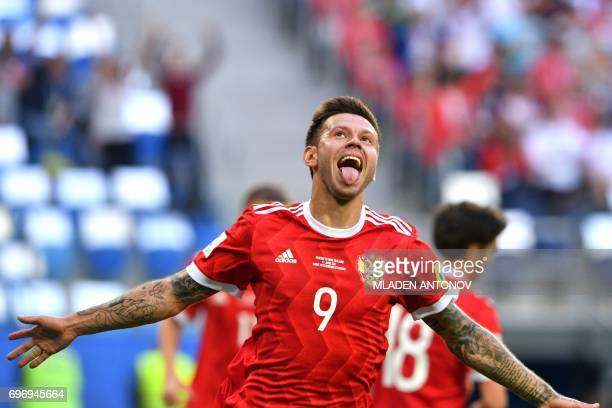 Russia's forward Fedor Smolov celebrates as he scores the team's second goal during the 2017 Confederations Cup group A football match between Russia...