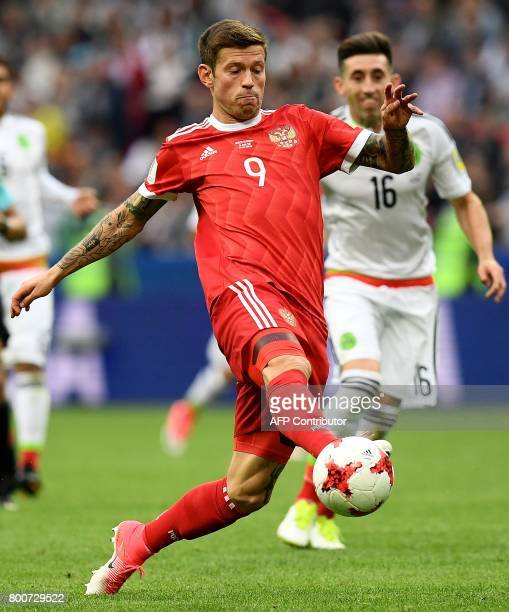 Russia's forward Fedor Smolov controls the ball during the 2017 Confederations Cup group A football match between Mexico and Russia at the Kazan...
