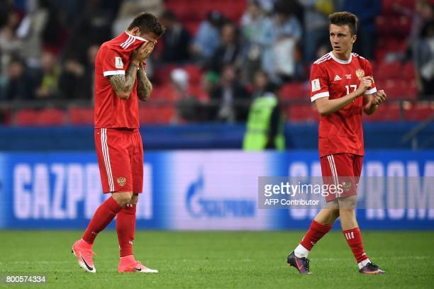 Russia's forward Fedor Smolov reacts after Russian lost 21 in the 2017 Confederations Cup group A football match between Mexico and Russia at the...
