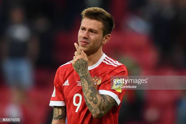 Russia's forward Fedor Smolov reacts as he acknowledges the fans after Russia lost 21 in the 2017 Confederations Cup group A football match between...