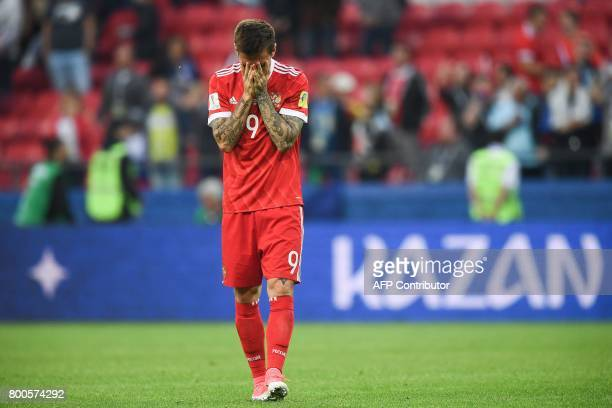 Russia's forward Fedor Smolov reacts as he acknowledges the fans after Russian lost 21 in the 2017 Confederations Cup group A football match between...