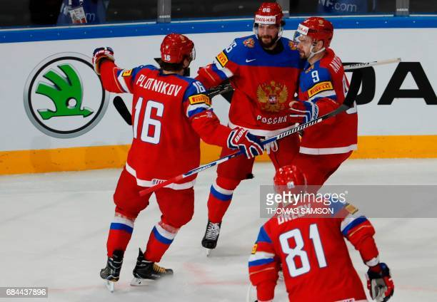 Russia's forward Nikita Kucherov is congratulated by teamates after scoring a goal during the IIHF Men's World Championship quarter final ice hockey...