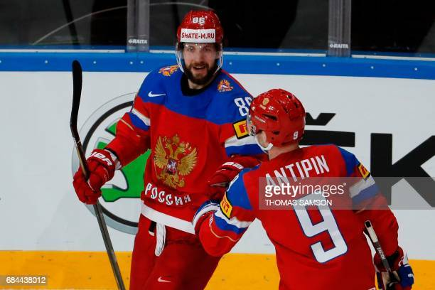 Russia's forward Nikita Kucherov is congratulated by teammates after scoring a goal during the IIHF Men's World Championship quarter final ice hockey...