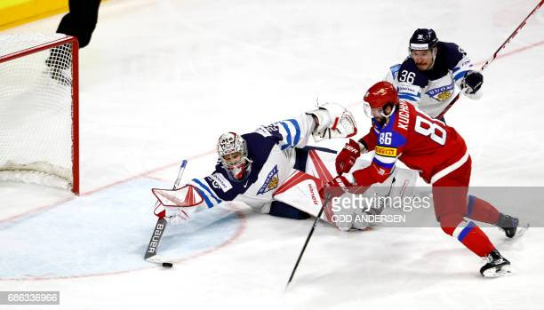 Russias forward Nikita Kucherov scores 53 past Finlands goalkeeper Harri Sateri during the IIHF Men's World Championship Ice Hockey bronze medal...