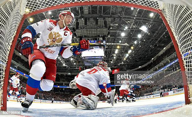 Russia's forward Pavel Datsyuk skates by his goalie Igor Shestyorkin during the Channel One Cup of the Euro Hockey Tour ice hockey match between...