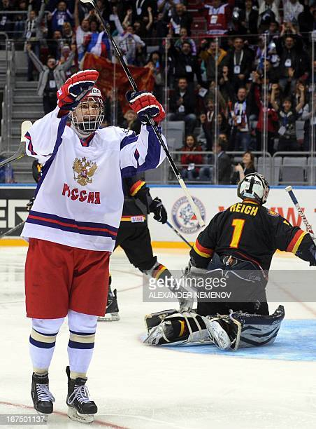 Russia's forward Ruzal Galeyev celebrates after scoring during a IIHF U18 International Ice Hockey World Championships quarterfinal match in Sochi on...