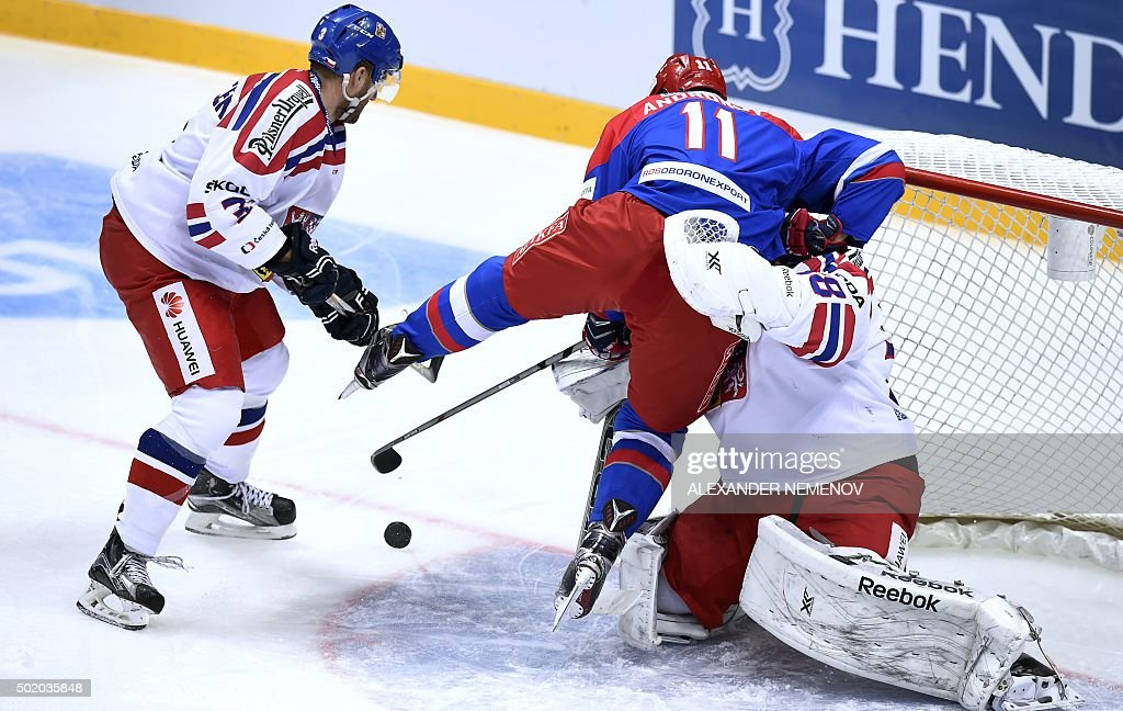 Russia's forward Sergei Andronov attacks Czech Republic's goalie Dominik Furch as Czech defenceman Tomas Voracek tries to stop him during a Channel...