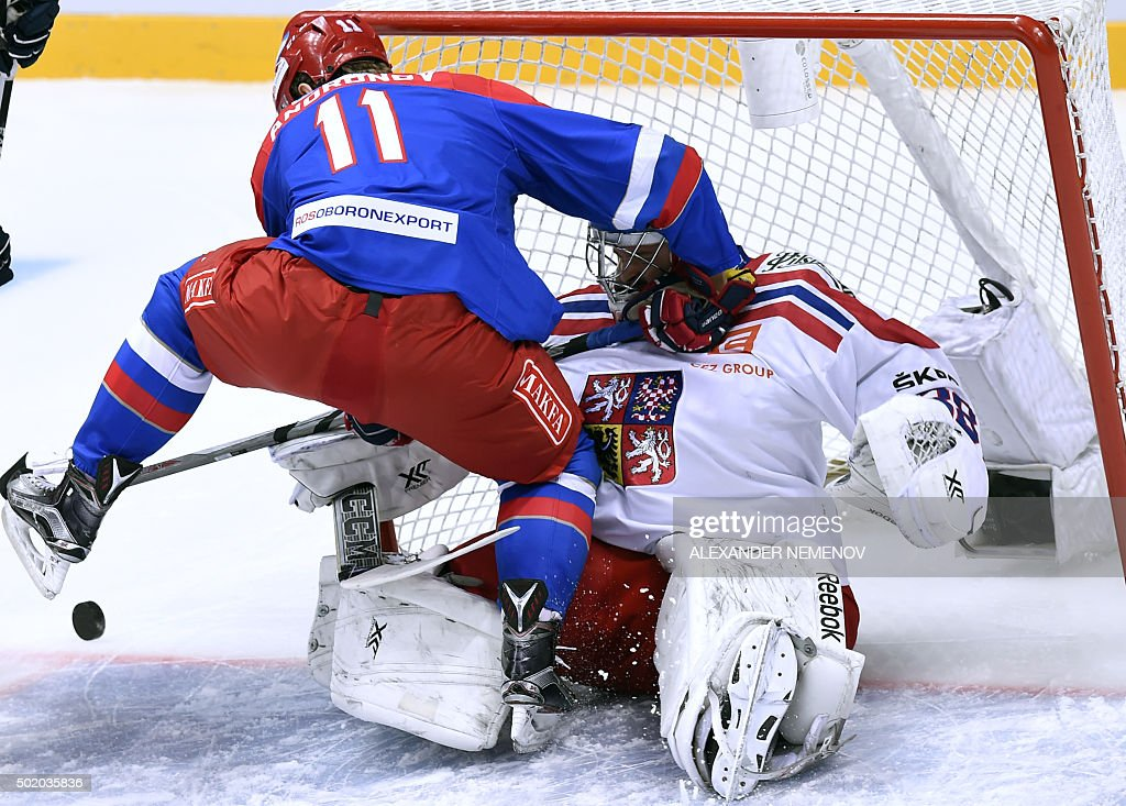 Russia's forward Sergei Andronov attacks with Czech Republic's goalie Dominik Furch during Channel One Cup hockey match of the Euro Hockey Tour match...