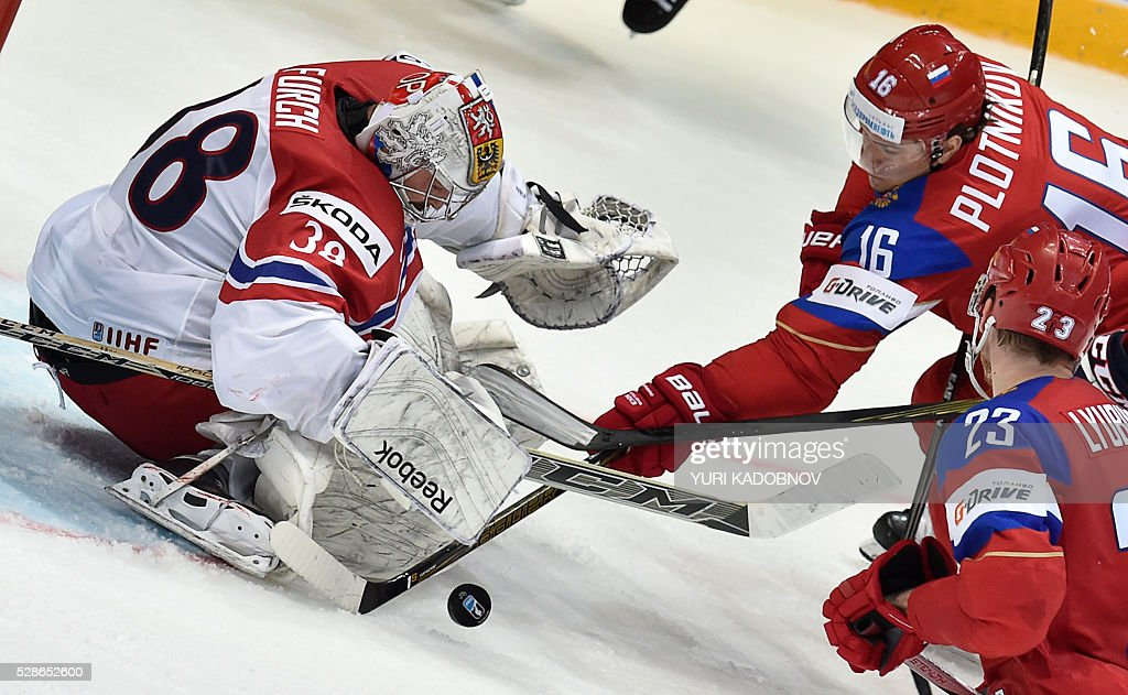 Russia's forward Sergei Plotnikov attacks Czech goalie Dominik Furch during the group A preliminary round game Czech Republic vs Russia at the 2016 IIHF Ice Hockey World Championship in Moscow on May 6, 2016. / AFP / YURI