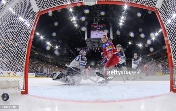 Russia´s forward Sergei Plotnikov scores his team's fourth goal during the IIHF Men's World Championship Ice Hockey bronze medal match between Russia...
