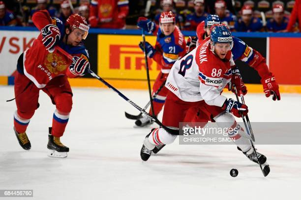 Russia's forward Sergei Plotnikov vies with Czech Republic's forward David Pastrnak during the IIHF Men's World Championship quarter final ice hockey...