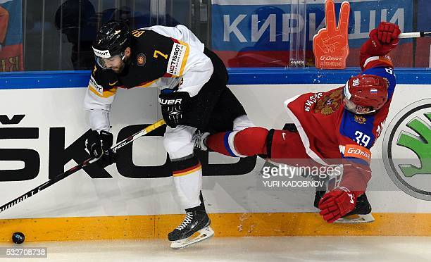Russia's forward Stepan Sannikov vies with Germany's defender Daryl Boyle during the quarterfinal game Russia vs Germany at the 2016 IIHF Ice Hockey...