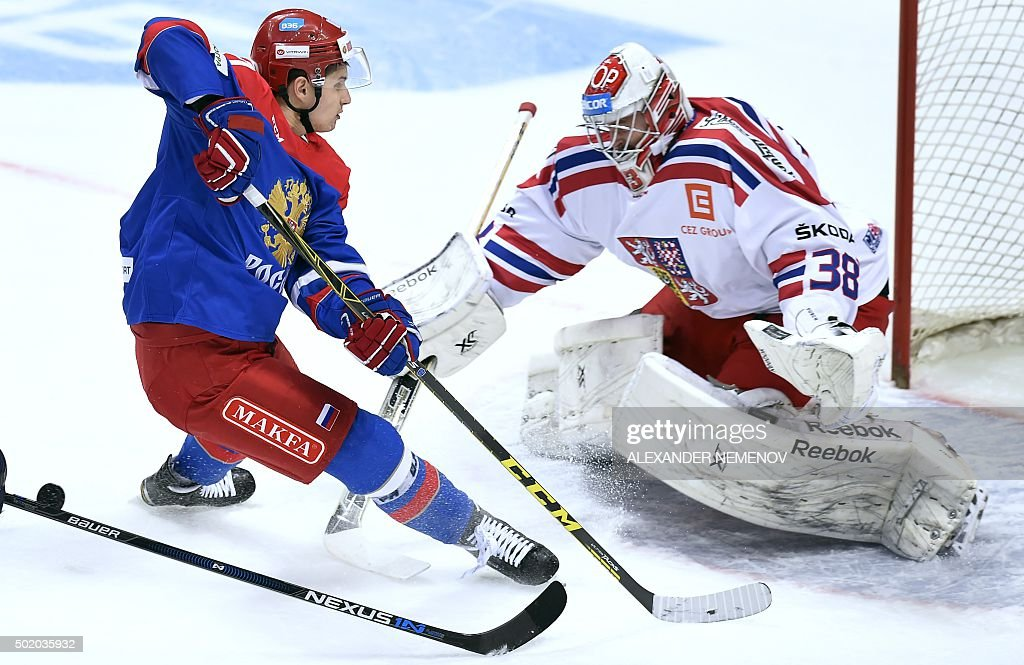 Russia's forward Vadim Shipachev attacks Czech Republic's goalie Dominik Furch during a Channel One Cup hockey match of the Euro Hockey Tour match...
