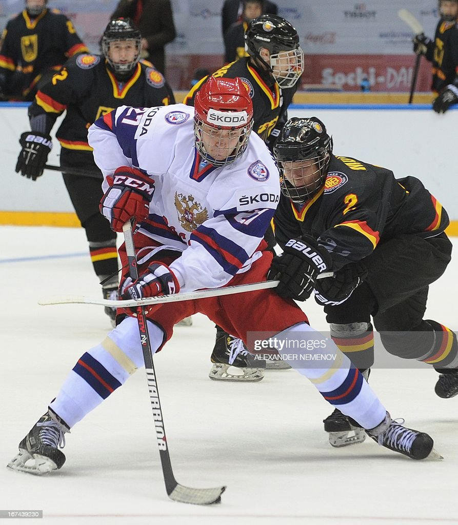 Russia's forward Valeri Nichushkin (front) scores his third goal against Germany during a quarter-final game of the IIHF U18 International Ice Hockey World Championship in Sochi on April 25, 2013.