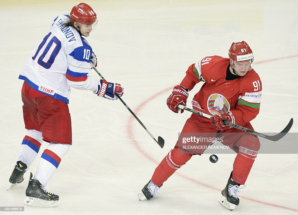 Russia's forward Viktor Tikhonov (L) vies with Belarus' defenceman Kirill Gotovets during a preliminary round group B Ice Hockey game between Russia and Belarus of the IIHF International Ice Hockey World Championship in Minsk on May 20, 2014.
