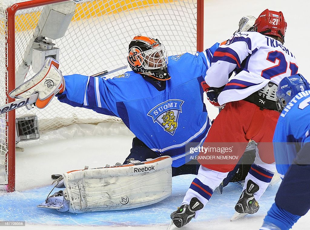 Russia's forward Vladimir Tkachyov (R) scores past Finland's goalie Juuse Saros during a bronze medal game of the IIHF U18 International Ice Hockey World Championship in Sochi on April 28, 2013.