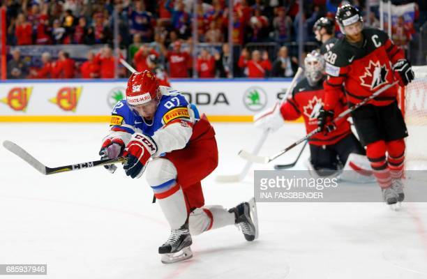 Russia´s forward Yevgeni Kuznetsov celebrates after scoring the opening goal during the IIHF Men's World Championship Ice Hockey semifinal match...