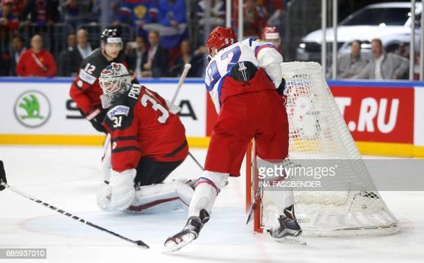 Russia´s forward Yevgeni Kuznetsov scores the opening goal past Canada´s goalkeeper Calvin Pickard during the IIHF Men's World Championship Ice...