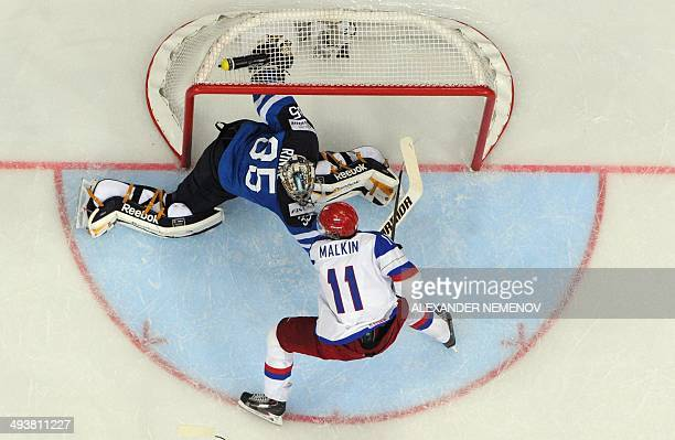 Russia's forward Yevgeni Malkin attacks Finland's goalie Pekka Rinne a gold medal game Russia vs Finland of the IIHF International Ice Hockey World...