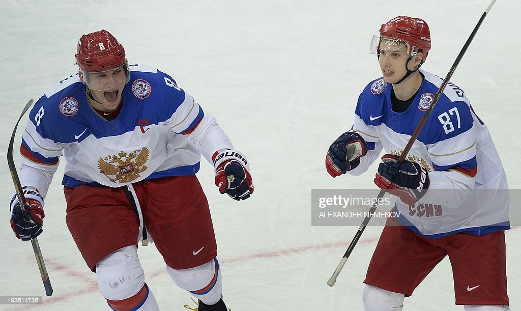 Russia's forwards Vadim Shipachyov (R) and Alexander Ovechkin celebrate a goal during a semifinal game Russia vs Sweden of the IIHF International Ice Hockey World Championship in Minsk on May 24, 2014.