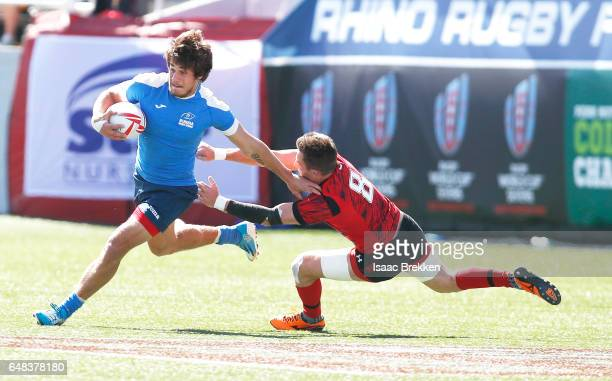 Russia's German Davydov carries the ball as Lloyd Evans defends during the USA Sevens Rugby tournament at Sam Boyd Stadium on March 5 2017 in Las...
