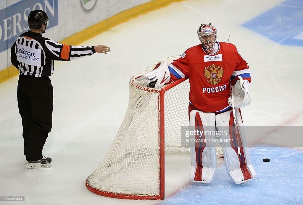 Russia's goalie <a gi-track='captionPersonalityLinkClicked' href=/galleries/search?phrase=Anton+Khudobin&family=editorial&specificpeople=722106 ng-click='$event.stopPropagation()'>Anton Khudobin</a> reacts as a referee points a goal past him during Euro Hockey Tour match between Russia and Sweden in Mytischi outside Moscow on April 24, 2015.