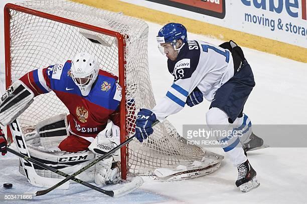 Russia's goalkeeper Alexander Georgiev and Finnland's Miska Siikonen vie during the 2016 IIHF World Junior Ice Hockey Championship final match...