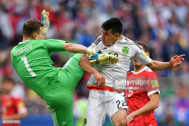 TOPSHOT Russia's goalkeeper Igor Akinfeev jumps to block Mexico's forward Hirving Lozano as he scores the second goal during the 2017 Confederations...