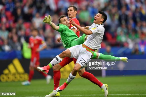 TOPSHOT Russia's goalkeeper Igor Akinfeev misses a goal by Mexico's forward Hirving Lozano uring the 2017 Confederations Cup group A football match...