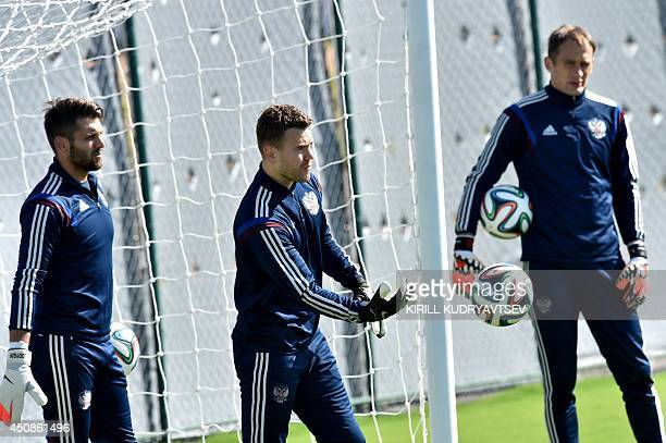 Russia's goalkeeper Igor Akinfeev Russia's goalkeeper Sergey Ryzhikov and Russia's goalkeeper Yuri Lodygin take part in a training session at the...