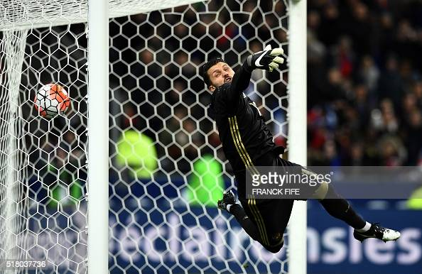 Russia's goalkeeper Juri Lodykin misses the ball scored by France's forward Dimitri Payet during the international friendly football match between...