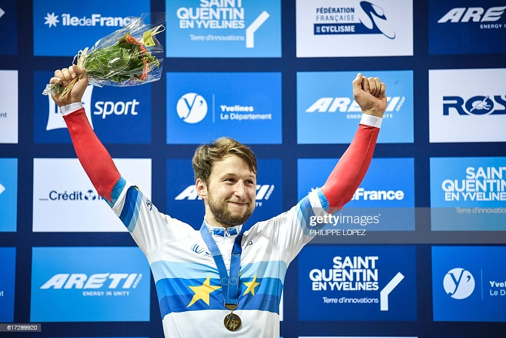Russia's gold medalist Pavel Yakushevskiy celebrates on the podium of the men's sprint race at the European Track Championships in Saint-Quentin-en-Yvelines on October 22, 2016. / AFP / PHILIPPE