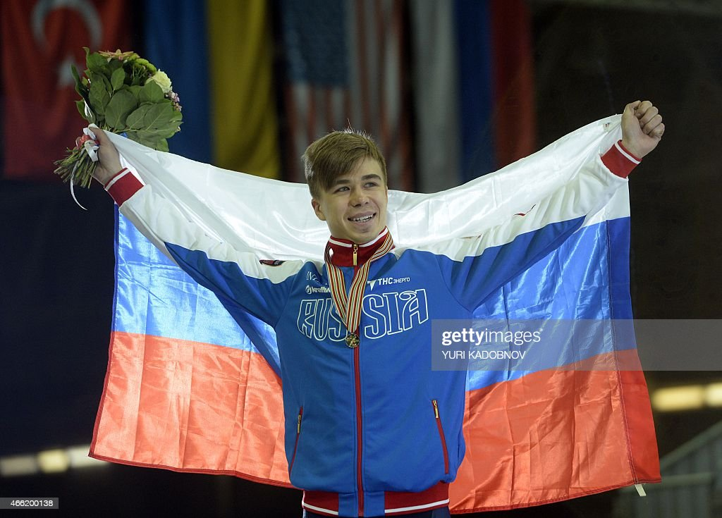 Russia's gold medalist <a gi-track='captionPersonalityLinkClicked' href=/galleries/search?phrase=Semen+Elistratov&family=editorial&specificpeople=8823657 ng-click='$event.stopPropagation()'>Semen Elistratov</a> poses during the men's 1500m medal ceremony at the ISU World Short Track Speed Skating Championships in Moscow on March 14, 2015.