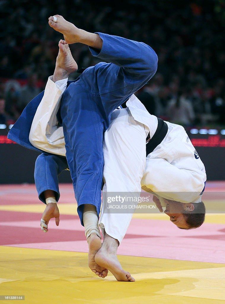 Russia's Grigorii Suleimin (white) fights against Mongolia's Bat-Erdene Davaadorj (blue) on February 10, 2013 in Paris, during the eliminatories of the Men -90kg of the Paris Judo Grand Slam tournament.