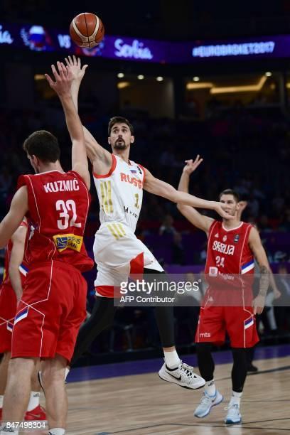 Russia`s guard Aleksei Shved goes to basket next to Serbia`s center Ognjen Kuzmic and guard Stefan Jovic during the FIBA Eurobasket 2017 men`s Semi...
