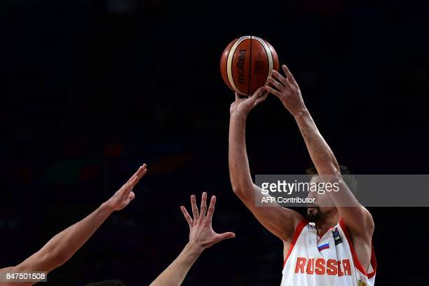TOPSHOT Russia`s guard Aleksei Shved tries to score during the FIBA Eurobasket 2017 men`s Semi Final basketball match between Russia and Serbia at...