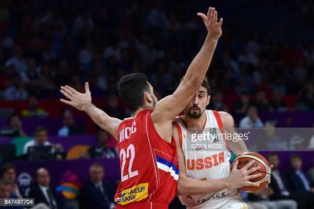 TOPSHOT Russia`s guard Aleksei Shved vies for the ball with Serbia`s guard Vasilje Mimic during the FIBA Eurobasket 2017 men`s Semi Final basketball...