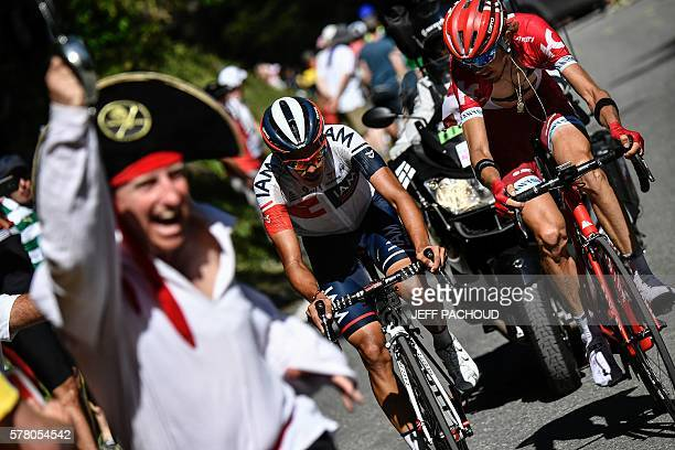 Russia's Ilnur Zakarin and Colombia's Jarlinson Pantano ride as fans cheer during the 1845 km seventeenth stage of the 103rd edition of the Tour de...