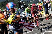 TOPSHOT Russia's Ilnur Zakarin and Poland's Rafal Majka ride in a breakaway as fans cheer during the 160 km fifteenth stage of the 103rd edition of...