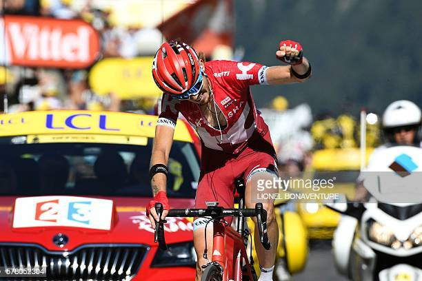 TOPSHOT Russia's Ilnur Zakarin celebrates as he crosses the finish line at the end of the 1845 km seventeenth stage of the 103rd edition of the Tour...