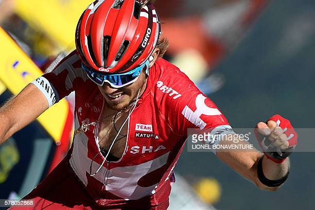 Russia's Ilnur Zakarin celebrates as he crosses the finish line at the end of the 1845 km seventeenth stage of the 103rd edition of the Tour de...