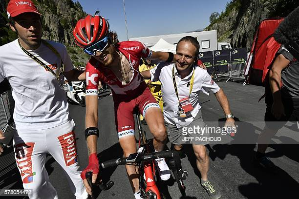 Russia's Ilnur Zakarin celebrates with his team's staff after crosssing the finish line at the end of the 1845 km seventeenth stage of the 103rd...