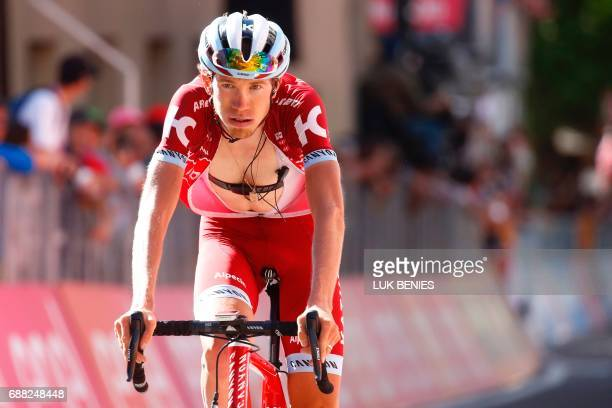 TOPSHOT Russia's Ilnur Zakarin of team Katusha Alpecin crosses the finish line of the 18th stage of the 100th Giro d'Italia Tour of Italy cycling...