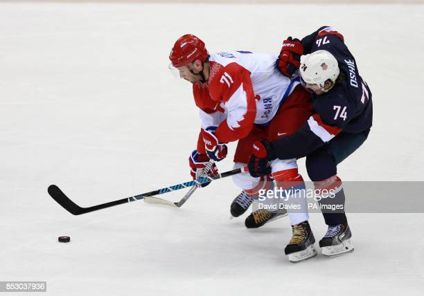 Russia's Ilya Kovalchuk tussles with USA's TJ Oshie during their Preliminary round match at the Bolshoy Ice Dome during the 2014 Sochi Olympic Games...
