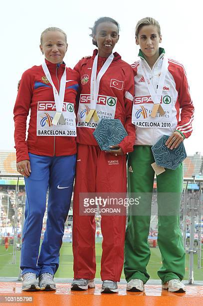 Russia's Inga Abitova Turkey's Elvcan Abeylegesse and Portugal's Jessica Augusto pose with their silver gold and bronze medals respectively on the...